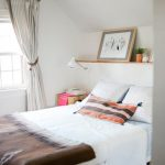 Simple wooden shelf over the bed a bed frame without headboard white bed comforter with brown scheme as decoration