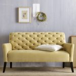 Small loveseat design in cream color scheme