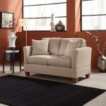 Small loveseat idea in white two white accent pillows dark brown wood side table with drawers