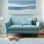 Soft blue loveseat in small size two accent pillows in blue