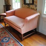 Soft pink loveseat with white stripe motifs