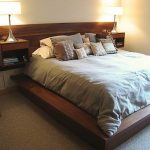 Solid wood wall mounted headboard idea with a pair of built in bedside table and bookshelves