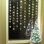 Sparkling window light drapery idea as the Christmas window decoration
