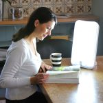 Sun Lamp For Sad With White Lighting On Large Wooden Table