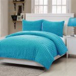 Textured turquoise comforter set for full sized modern bed frame with white headboard white bedside table a table lamp with turquoise lampshade