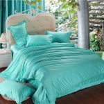 Turquoise bed comforter sets for classic styled bed frame white classic bedside table with table lamp