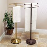 Two units of hand towel stands in gold and dark brown colors