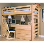 Unfinished wood loft bed with built in ladder and large desk a wood chair with navy blue cushion