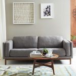 Vintage couch in grey with wood frame small round wood coffee table in vintage style