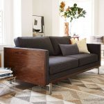 Vintage look couch with dark wood finished wood frame and black cushions