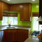 Vividly green hue for kitchen wall system natural brown kitchen cabinets white kitchen countertop
