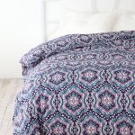 White Bed Frame With Purple Urban Outfitter Bedding Design