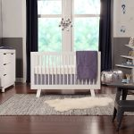 White Letto Hudson baby crib a white storage solution a set of dark grey kids chairs and table tree shaped bookshelf in white grey bedroom rug white shag rug