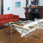 White Wassily Chair Reproduction With Red Sofa Glass Top Table Luxury Rug And Decorative Fireplace