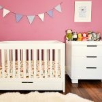 White baby crib with storage by Letto Hudson a unit of storage solution in white with a lot animal stuffs