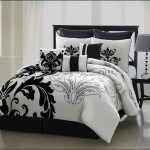 White california king bed comforter set with blacks floral pattern black wood bedside table with table lamp