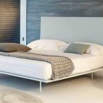 White minimalist bed frame with high white headboard