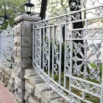 White painted decorative metal fencing system in classic style