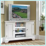 White painted wood corner TV stand with shelving unit and cabinets underneath