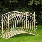 White stained metal garden bridge idea with artistic handrails