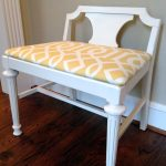 White vanity bench seat with back feature and yellow white cushion