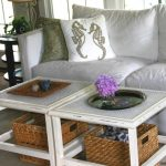 White wood framed coffee tables with baskets underneath