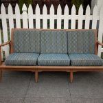 Wood framed couch with cushions