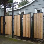 Wood planks rail system with black metal frames as decorative home fencing system
