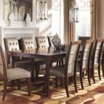 Wooden Formal Dining Room Sets For 8 With decorative Rug And Unique Chandelier