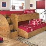 Wooden Small Bunk Beds For Toddlers With Red Bedding And Some Drawers
