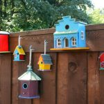 Wooden home fencing idea with colorful home construction miniatures