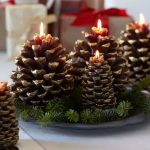 pinecone display with candles,