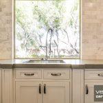 Awesome Warm Kitchen With Carrara Marble Backsplash Near Steel Sink