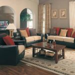 Black Leather Sofa With Random Color Of Pillows For Sofas Decorating