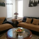 Black Leather With Brown Slipcovers For Sectional Couches And Round Glass Coffee Table