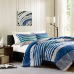 Blue White Stripped Comforter Sets For Men With Dark Wooden Bed Frame And Side Table