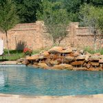 Custome Natural Swimming Pool With Adorable Waterfall And White Chair