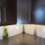 Dark Wooden Kitchen Storage With White Carrara Marble On Backsplash