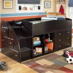 Dark Wooden Twin Bed With Drawers Underneath And Stairs