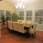 Dining Room Morning Room Pretty Chandelier White Sofa Wood Table And Floor Shader On Windows