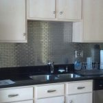 Ikea Stainless Steel Backsplash With Subway Tile And Light Wooden Cabinet