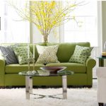 Light Green Sofa With Green Patterned Pillows For Sofas Decorating Glass Round Table Black Standing Lamp And Fur Rug