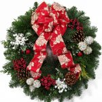 Pictures Of Christmas Wreaths With Snow Rose Ribbon