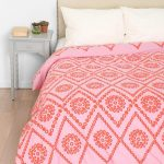 Red Pink Plum And Bow Bedding With White Pillows And Grey Side Table