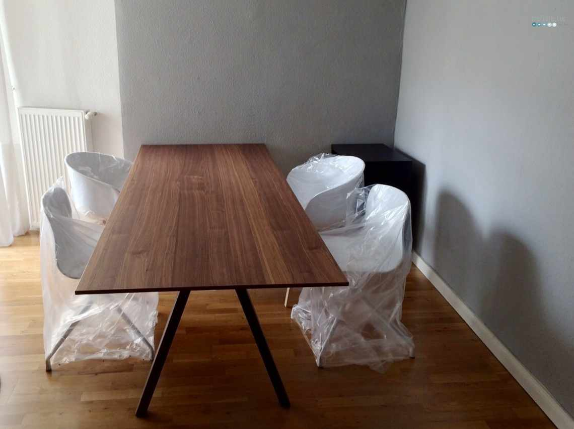 Simple Wooden Ikea Stockholm Dining Table With White Chairs