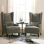 Stylish Grey Doub;e High Back Chairs For Living Room With Round Side Table Floor Lamp And Zebra Rug