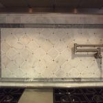 Tumble Carrara Backplash With Marble Design