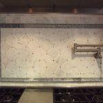 Tumble Carrara Backplash With Marble Design