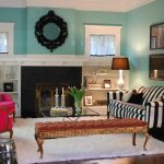 Turquoise Wall Living Room With Striped Black And WHite Sofa Near Fireplace With Long Bench White Rug Cabinet And Frames