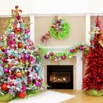 Two Unique Christmas Tree Toppers With Red Light And Colorful Design Around Fireplace